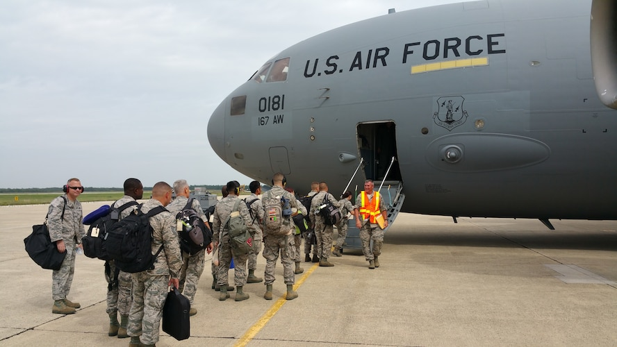 U.S. Air Force Airmen, from the 177th Fighter Wing of the New Jersey Air National Guard, board a West Virginia ANG C-17 Globemaster III at Atlantic City International Airport, N.J., on July 13, 2015, to travel to Thracian Star, a bilateral training exercise to enhance interoperability with the Bulgarian air force at Graf Ignatievo Air Base, Bulgaria. (U.S. Air National Guard photo by Master Sgt. Andrew J. Moseley/Released)