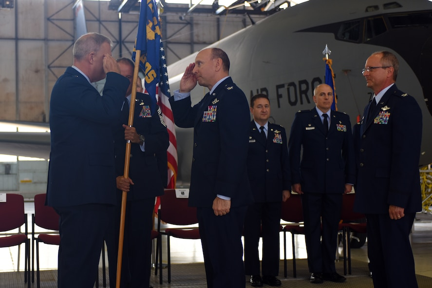 U.S. Air Force Col. Mark Auer salutes after receiving the 121st Air Refueiling Wing guidon from Brig. Gen. Stephen Markovich July 14, 2015, at Rickenbacker Air National Guard Base, Ohio. The 121st ARW held a change of command ceremony to transfer command from Col Jim Jones to Auer. (U.S. Air National Guard photo by Master Sgt. Ralph Branson/Released)
