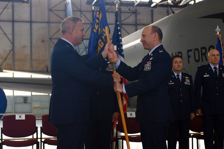 U.S. Air Force Col. Mark Auer receives the 121st Air Refueiling Wing guidon from Brig. Gen. Stephen Markovich July 14, 2015, at Rickenbacker Air National Guard Base, Ohio. The 121st ARW held a change of command ceremony to transfer command from Col Jim Jones to Auer. (U.S. Air National Guard photo by Master Sgt. Ralph Branson/Released)