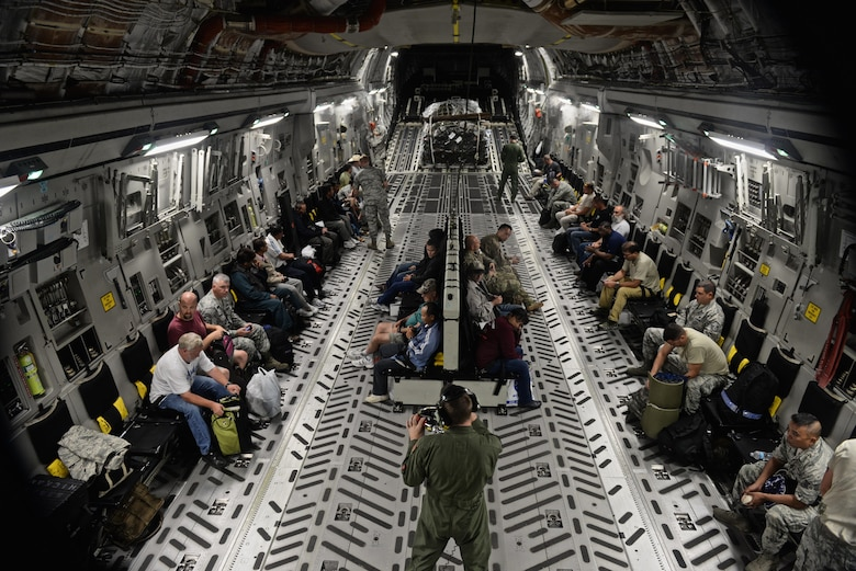 Wake Island Airfield staff and 36th Contingency Group Airmen prepare for departure in a C-17 Globemaster III July 20, 2015, at Andersen Air Force Base, Guam. A team with the 36th CRG deployed to Wake Island to assist in airfield storm recovery efforts after the atoll was evacuated a few days earlier in preparation of Typhoon Halole. (U.S. Air Force photo/Senior Airman Alexander W. Riedel)