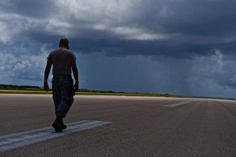 Capt. Clark Morgan, a 36th Mobility Response Squadron contingency engineer, surveys the pavement on Wake Island Airfield for cracks and other damage July 20, 2015, on Wake Island. A team with the 36th CRG at Andersen Air Force Base, Guam, deployed to the atoll to assist in airfield storm recovery efforts, and surveyed the runway to ensure adequate flightline safety. (U.S. Air Force photo/Senior Airman Alexander W. Riedel)