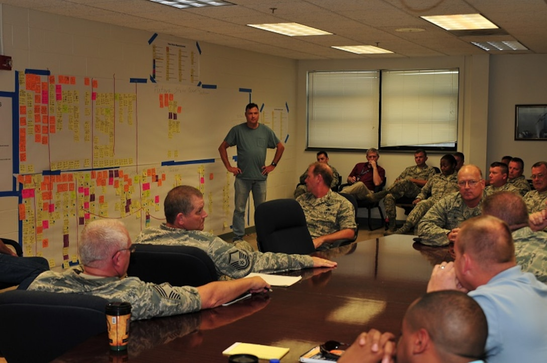 Master Sgt. Mitchell Sojourner fielded questions during the 172d Airlift Wing Maintenance outbrief that followed a Value Stream Mapping workshop held July 16-17.  Seen on the lower portion of the wall, is the current state map.  The wall's upper portion is the future state map.  172d AW personnel coordinated with Boeing represented to construct recommendations for further enhancing the wing's maintenance efficiency.  Photo by TSgt Ed Staton