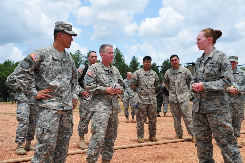 SOTO CANO AIR BASE, Honduras – Maj. Gen. K. K. Chinn, U.S. Army South commanding general (left), receives a briefing from U.S. Air Force Staff Sgt. Kimberly Grady, a non-commissioned officer with Joint Task Force-Bravo's logistics directorate (right), during his visit to Mocoron, Honduras, July 18, 2015. Brady briefed the general on an ongoing project to increase the fuel-storage capacity at Mocoron, to expand JTF-Bravo's ability to support Honduran Armed Forces as they counter transnational organized crime in the region of Gracias a Dios. (U.S. Air Force photo by Capt. Christopher Love)