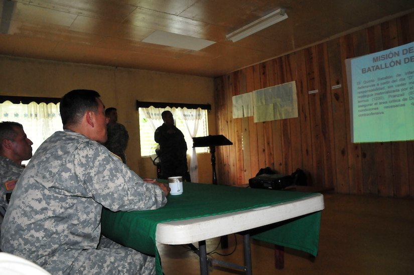 SOTO CANO AIR BASE, Honduras – Maj. Gen. K. K. Chinn, U.S. Army South commanding general (center left), and Command Sgt. Maj. Carlos Olvera, Army South command sergeant major (far left), receive a briefing from Honduran Army Colonel Jose Angel Juarez, Commander of the 5th Battalion in Mocoron, Honduras, July 18, 2015. Chinn and his staff visited Mocoron to learn how Honduran forces are countering transnational organized crime and building partnerships in the remote area of Gracias a Dios. (U.S. Air Force photo by Capt. Christopher Love)