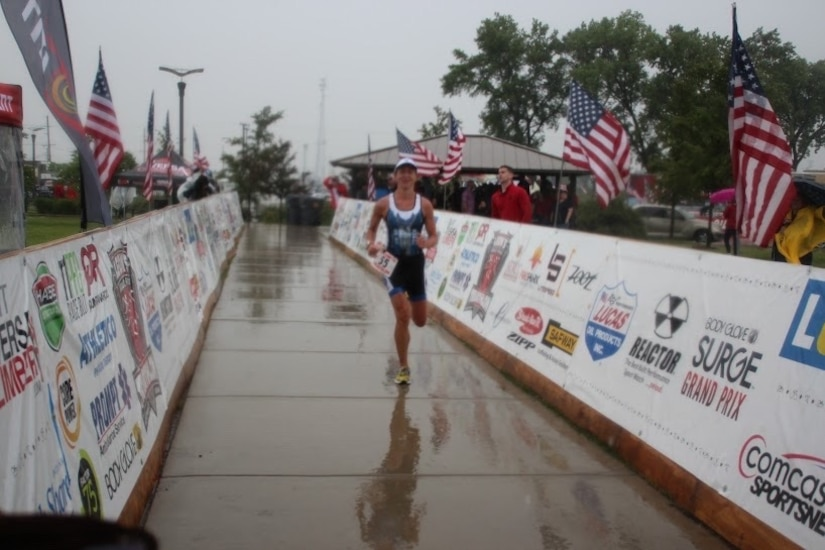 Major Jamie Turner runs toward the finish line during the Armed Forces Triathlon Championship race in Hammond, Indiana, June 7, 2015. Turner continued her world-class triathlete success as the second female to cross the finish line and automatically qualified as one of six athletes to compete on the women's team at the Military World Games in Mungyeong, South Korea, Oct. 2-11, 2015. Turner is a C-17 pilot with the 317th Airlift Squadron. (Courtesy photo)