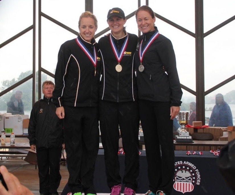Major Jamie Turner proudly stands on the winners' podium with 2nd Lt. Samone Franzese and 2nd Lt. Jessica Clay at the Armed Forces Triathlon Championship race in Hammond, Indiana, June 7, 2015. Turner (right) continued her world-class triathlete success as the second female to cross the finish line and automatically qualified as one of six athletes to compete on the women's team at the Military World Games in Mungyeong, South Korea, Oct. 2-11, 2015. Turner is a C-17 pilot with the 317th Airlift Squadron. Franzese, a medical student with the U.S. Army, finished first, and Clay, from Camp Casey, Korea finished third in the competition. (Courtesy photo)