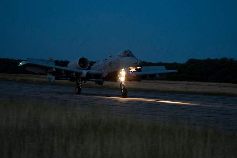 A 354th Expeditionary Fighter Squadron A-10C Thunderbolt II aircraft takes off during an austere landing training exercise at Nowe Miasto, Poland, July 20, 2015. The group of A-10 pilots performed unimproved surface landings during the night and had no lighting on the runway. (U.S. Air Force photo by Airman 1st Class Luke Kitterman/Released)