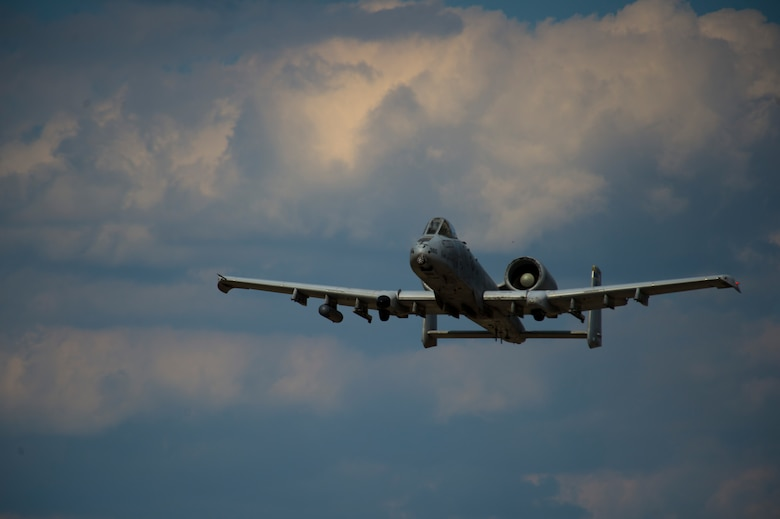 A 354th Expeditionary Fighter Squadron A-10C Thunderbolt II aircraft soars through the sky during an austere landing training exercise at Nowe Miasto, Poland, July 20, 2015. The 354th EFS is currently operating at Lask Air Base, Poland. (U.S. Air Force photo by Airman 1st Class Luke Kitterman/Released)