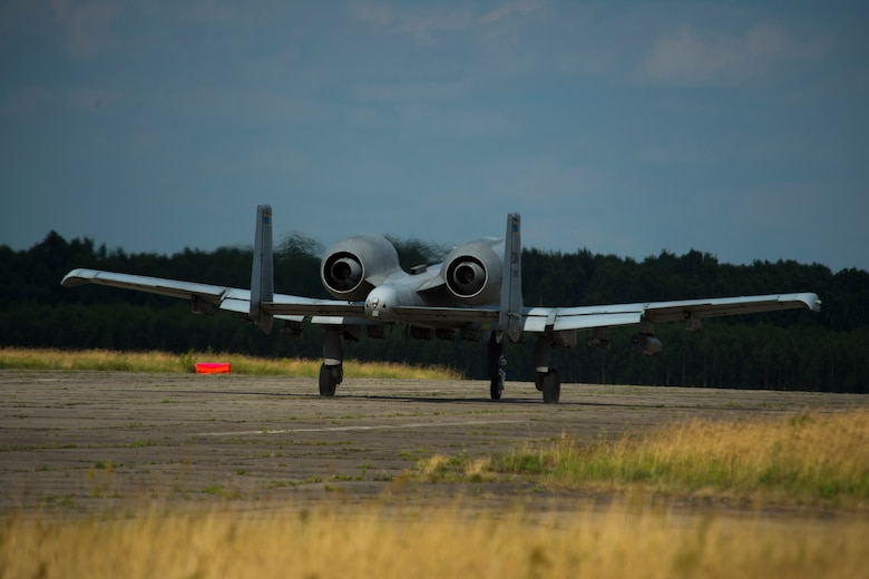 A 354th Expeditionary Fighter Squadron A-10C Thunderbolt II aircraft travels down a runway during an austere landing training exercise at Nowe Miasto, Poland, July 20, 2015. The rugged surface conditions of the runway allow pilots to closely simulate landing conditions in a deployed environment. (U.S. Air Force photo by Airman 1st Class Luke Kitterman/Released)