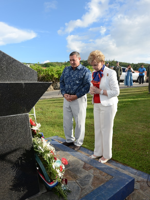 Eddie Calvo, governor of Guam, and Madeleine Bordallo, Guam's U.S. Congress representative, pay respects to the fallen Airmen during the Raider 21 memorial July 21, 2015, in Adelup, Guam. The monument, constructed at the Ricardo J. Bordallo Governor's Complex in 2009, was built and marked with the names of the six Airmen who lost their lives. (U.S. Air Force photo by Airman 1st Class Arielle Vasquez/Released)