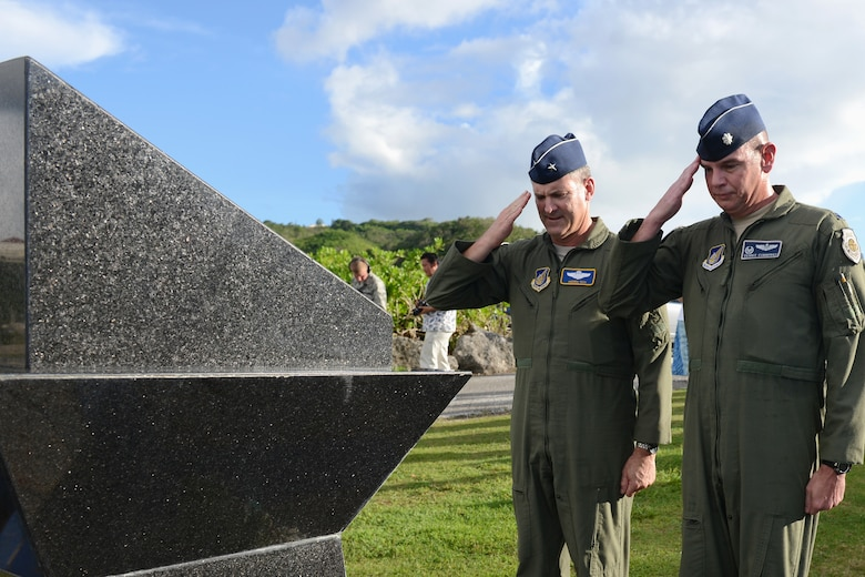 Brig. Gen. Andrew Toth, 36th Wing commander, and Lt. Col. Dennis Cummings, 20th EBS commander, pay respects to the fallen Airmen during the Raider 21 memorial July 21, 2015, in Adelup, Guam. The memorial service was held in remembrance of Raider 21, a B-52 Stratofortress aircrew that died during a Liberation Day flyover July 21, 2008, when their aircraft crashed. (U.S. Air Force photo by Airman 1st Class Arielle Vasquez/Released)