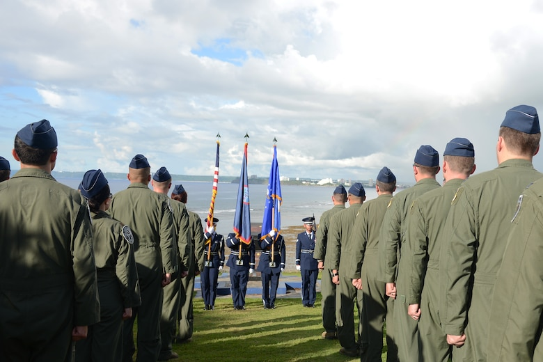 Airmen from the 20th Expeditionary Bomb Squadron currently deployed to Andersen from Barksdale Air Force Base, Louisiana, stand at attention for the Guam Hymn during the Raider 21 memorial ceremony July 21, 2015, in Adelup, Guam. Members of Team Andersen and representatives from the Government of Guam gathered together to remember the six Airmen who lost their lives when a B-52 Stratofortress with call sign  Raider 21 crashed off the coast of Guam July 21, 2008. (U.S. Air Force photo by Airman 1st Class Arielle Vasquez/Released)