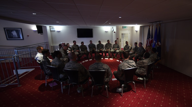 Air Force Chief of Staff Gen. Mark A. Welsh III discusses current and future challenges with company grade officers at Royal Air Force Croughton, England, July 16, 2015. Welsh held roundtable discussions to connect directly with various groups of Airmen throughout the wing. (U.S. Air Force photo/Staff Sgt. Jarad A. Denton)