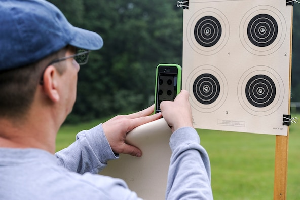 Lt. Col. Mark Gould takes a picture of his grouping as he admires his shots during a training class in New Freedom, Pa., June 26, 2015. Gould, a foreign liaison officer for the Defense Intelligence Agency's Office of Partner Engagement at the Pentagon, has been involved in competitive shooting for the past 23 years and has been a member of the Air Force International Rifle Team for 17 years. (U.S. Air Force photo/Staff Sgt. Christopher Gross)