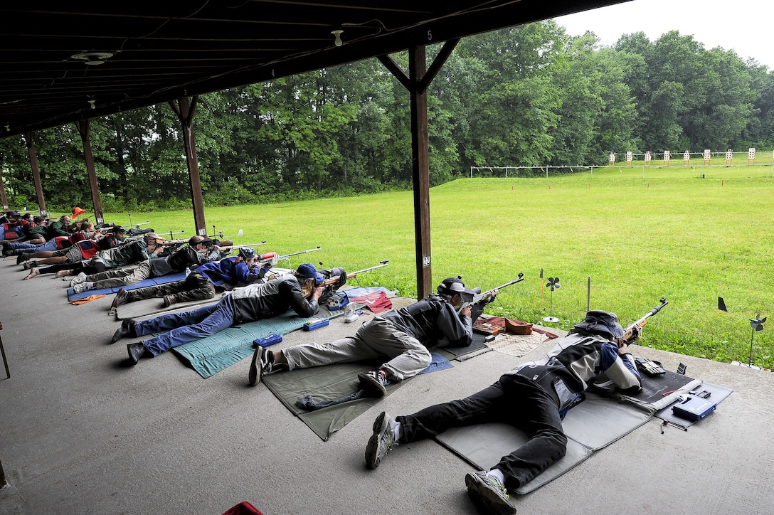 Lt. Col. Mark Gould (far right) aims downrange at his target during the Dave Cramer Memorial Smallbore Regional Prone Metric NRA Regional Tournament in New Freedom, Pa., June 27, 2015. Gould, a foreign liaison officer for the Defense Intelligence Agency's Office of Partner Engagement at the Pentagon, finished second in his class and fourth overall at the tournament. Gould has been involved in competitive shooting for the past 23 years and has been a member of the Air Force International Rifle Team for 17 years. (U.S. Air Force photo/Staff Sgt. Christopher Gross)