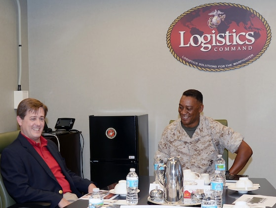 Georgia's ninth Commissioner of Labor, Mark Butler, meets with Maj. Gen. Craig Crenshaw, commanding general, Marine Corps Logistics Command, July 22, during an afternoon consisting of briefs, tours and fellowship.