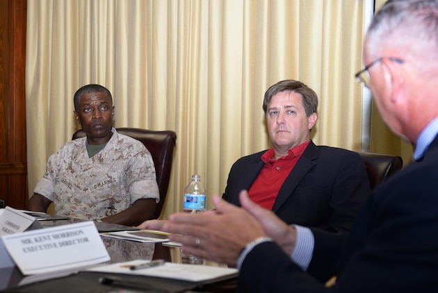 Georgia's ninth Commissioner of Labor, Mark Butler, (center) and his staff joined officials here at Marine Corps Logistics Base Albany and Marine Corps Logistics Command, July 22, for an afternoon consisting of briefs, tours and fellowship.