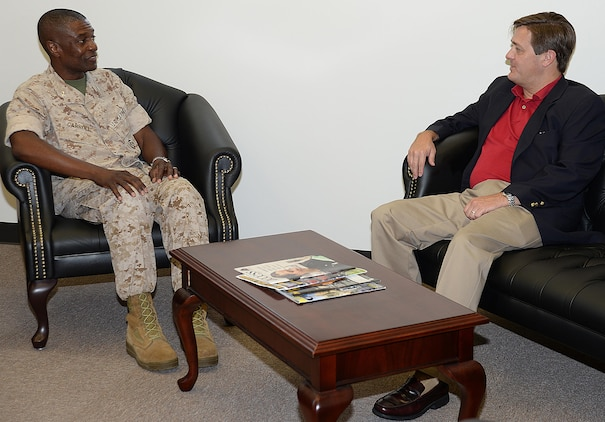 Georgia's ninth Commissioner of Labor, Mark Butler, visits with Col. James Carroll III, commanding officer, Marine Corps Logistics Base Albany, July 22, during an afternoon consisting of briefs, tours and fellowship.