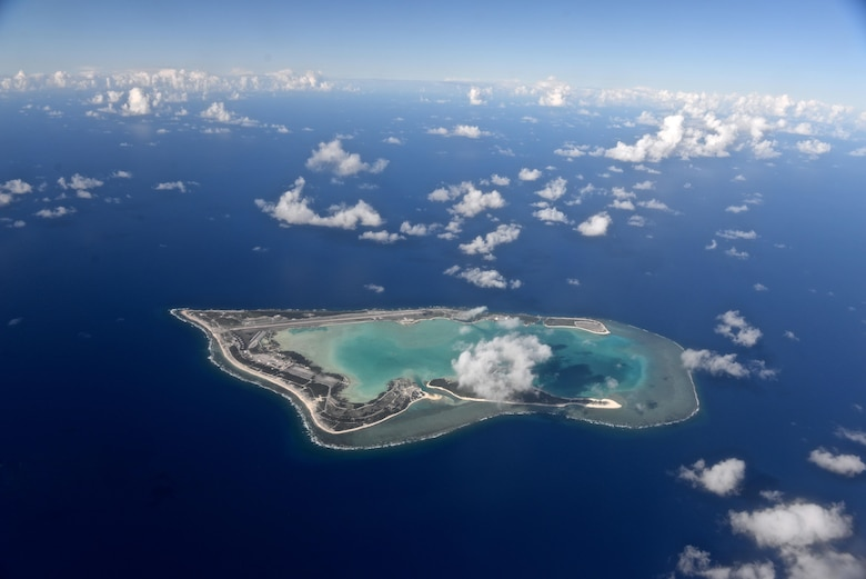 Wake Island, pictured as viewed from the north, was completely evacuated July 15, 2015, in preparation for Typhoon Halola closing in on the small atoll. A team with the 36th Contingency Response Group deployed from Andersen Air Force Base, Guam, to the atoll July 20, 2015, to assist permanently assigned airfield staff in storm recovery efforts. (U.S. Air Force photo by Senior Airman Alexander W. Riedel/Released)