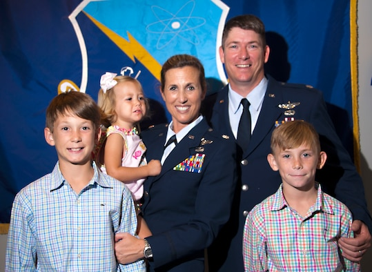 Lt. Col. Loralie Rasmussen, Officer Training School Detachment 12 commander, and her husband, Lt. Col. Reid Rasmussen, Air War College student, take a moment with their family after the change of command ceremony July 16, 2015, Maxwell Air Force Base, Ala. The couple has three children, from left to right, Foster, Amelia Grace and Emmett. (U.S. Air Force photo/Airman 1st Class Alexa Culbert)