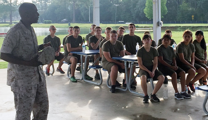 Col. James Carroll III, commanding officer, Marine Corps Logistics Base Albany, speaks to 30 members of the Colquitt County High School Marine Corps Junior Reserve Officers' Training Corps Summer Leadership Camp, July 23. The group returned here for their second visit.