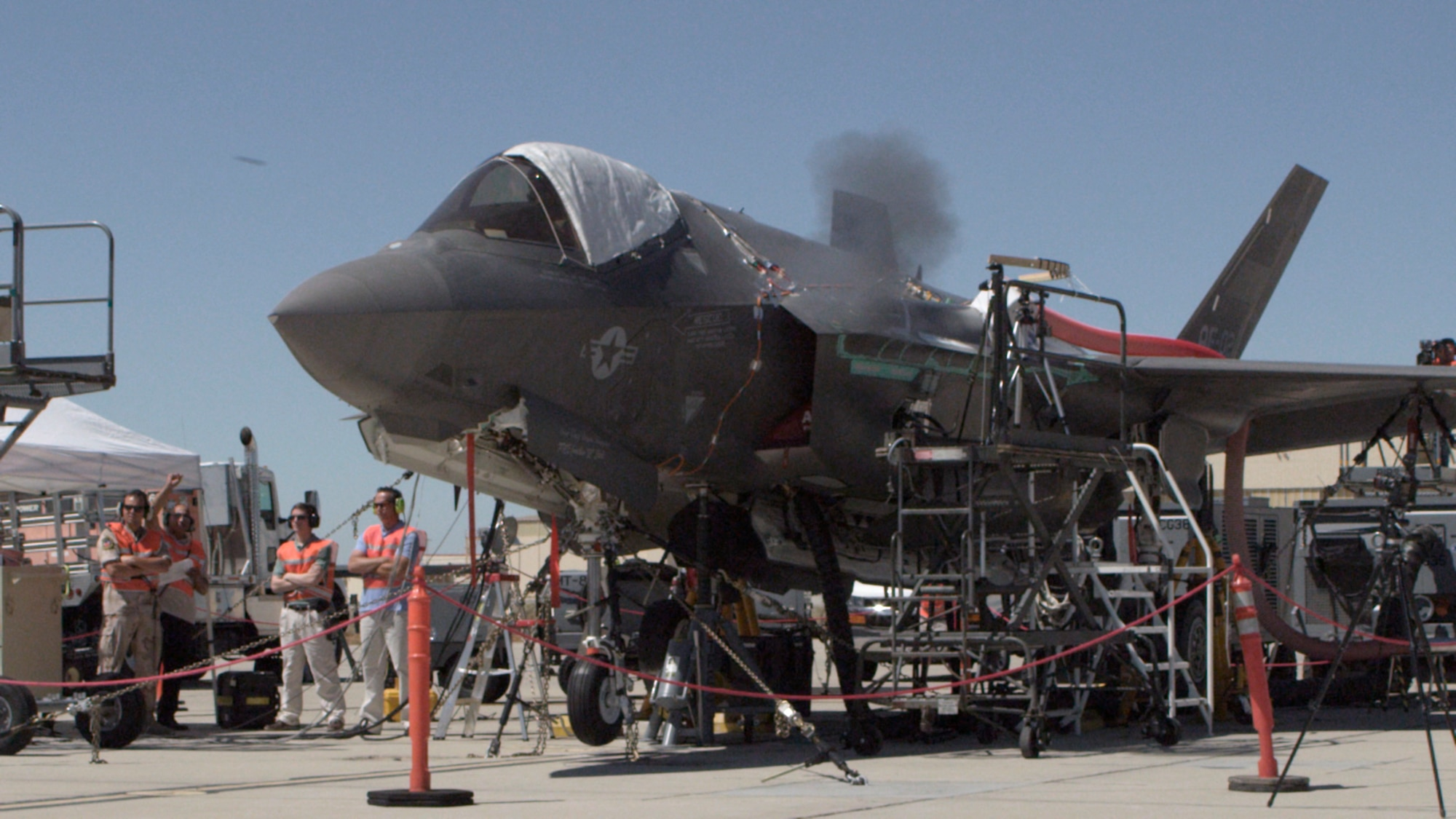 An F-35A Lightning II, tail number AF-2, fires a burst of rounds down range at the Edwards Gun Harmonizing Range July 17, 2015, on Edwards Air Force Base, Calif. The F-35 Joint Strike Fighter Integrated Test Force is in the process of testing the F-35A Lightning II's newest munitions asset; a four-barrel Gatling gun that fires 25 mm rounds, known as the GAU-22/A. (Courtesy photo/Darin Russell)