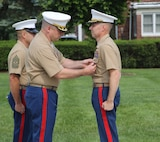 U.S. Marine Corps Lt. Col. Gerald Murphy, left, awards U.S. Marine Corps Lt. Col. Donald Moor, 4th Marine Corps District Executive Officer, with the Meritorious Service Medal during a ceremony at the Defense Distribution Center Susquehanna in New Cumberland, Pennsylvania, July 2, 2015. Moor, a Lebanon, Missouri native, retired from active duty after serving 24 years in the United States Marine Corps. (U.S. Marine Corps photo by Cpl. Kyle Welshans/Released)