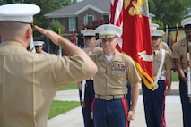 U.S. Marine Corps Lt. Col. Donald Moor, 4th Marine Corps District Executive Officer, salutes Lt. Col. Gerald Murphy, 4th MCD Operations Officer, during his retirement ceremony at the Defense Distribution Center Susquehanna in New Cumberland, Pennsylvania, July 2, 2015. Moor, a Lebanon, Missouri native who retired after 24 years of service, was awarded the Meritorious Service Medal for his service at the recruiting district. (U.S. Marine Corps photo by Cpl. Kyle Welshans/Released)