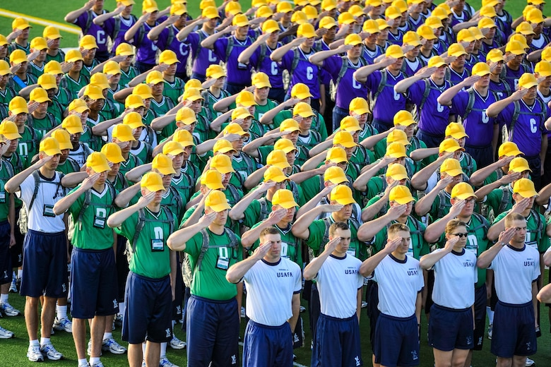 Basic cadets at the U.S. Air Force Academy salute during a ceremony before Field Day, July 10, 2015, in Colorado Springs, Colo. Field Day is an annual competitive event that marks the halfway point through basic cadet training. (U.S. Air Force photo/Liz Copan)