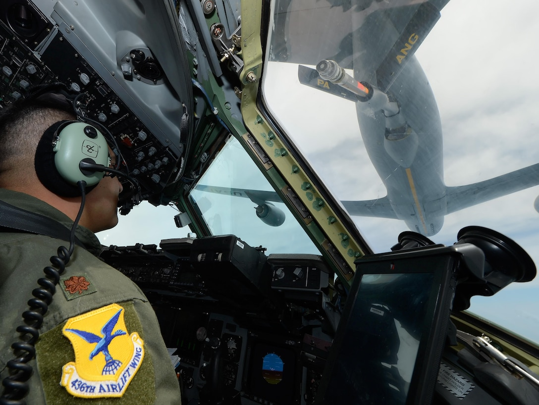 Maj. Dennis Menjivar, the 436th Airlift Wing Inspector General chief of exercises and a C-17 Globemaster III pilot, monitors the approach to contact position with a KC-135R Stratotanker during a training mission over Ohio July 13, 2015. The KC-135R is assigned to the 171st Air Refueling Wing, Pennsylvania Air National Guard. (U.S. Air Force photo/Greg L. Davis)