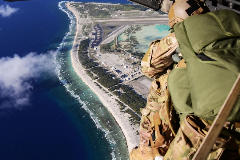 A rescue jumpmaster from the 320th Special Tactics Squadron uses rescue jumpmaster procedures to allow a special tactics team to conduct military freefall onto an unknown and unmarked drop zone.   Members from the 353rd Special Operations Group worked with the 36th Contingency Response Group from Andersen Air Base, Guam, to open Wake Island air field after Typhoon Halola passed through the island. (U.S. Air Force photo by Tech. Sgt. Kristine Dreyer)