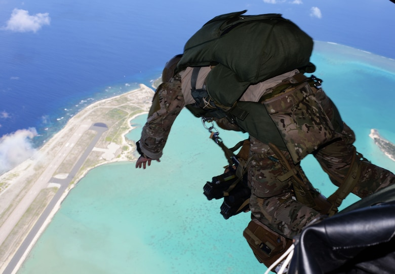 A special tactics team from the 320th Special Tactics Squadron jumps out of an MC-130H Combat Talon II to infil onto Wake Island July 20, 2015.  Members from the 353rd Special Operations Group worked with the 36th Contingency Response Group from Andersen Air Base, Guam, to open Wake Island air field after Typhoon Halola passed through the island. (U.S. Air Force photo  by Tech. Sgt. Kristine Dreyer)