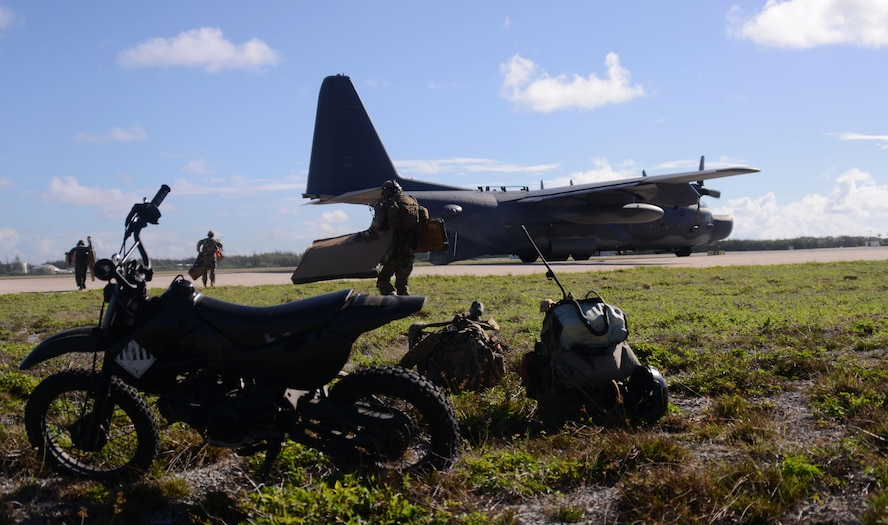 A special tactics team from the 320th Special Tactics Squadron unloads equipment from an MC-130H Combat Talon II on Wake Island July 20, 2015. After conducting military freefall operations onto the unmarked drop zone, the operators were able to clear the runway and receive the first aircraft within 20 minutes.   Members from the 353rd Special Operations Group worked with the 36th Contingency Response Group from Andersen Air Base, Guam, to open Wake Island air field after Typhoon Halola passed through the island. (U.S. Air Force photo  by Tech. Sgt. Kristine Dreyer)