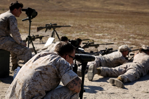 Marines with 1st Reconnaissance Battalion, 1st Marine Division, 1st Marine Expeditionary Force, conduct unknown distance shooting while their instructors watch during the Pre-Scout Sniper Course aboard Marine Corps Base Camp Pendleton, Calif., July 17, 2015. The six-week long course is designed to prepare and screen students for the follow-on training at Scout Sniper Basic School. (Photo by LCpl. Danielle Rodrigues/Released)
