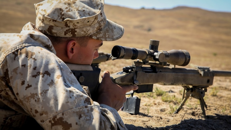 Marines with 1st Reconnaissance Battalion, 1st Marine Division, 1st Marine Expeditionary Force, conduct unknown distance shooting during the Pre-Scout Sniper Course aboard Marine Corps Base Camp Pendleton, Calif., July 17, 2015. The six-week long course is designed to prepare and screen students for the follow-on training at Scout Sniper Basic School. (Photo by LCpl. Danielle Rodrigues/Released)