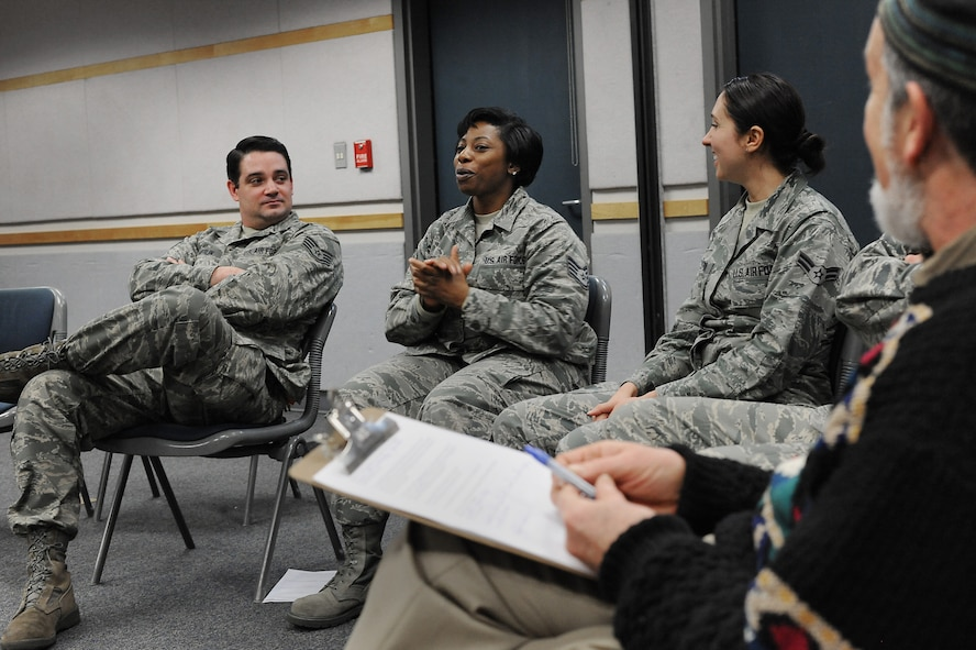 Oregon Air National Guard Staff Sgt. Jennifer Scott, center, shares some of experiences following one-on-one compassionate listening exercise during the 142nd Fighter Wing's Diversity and Inclusion Counsel meeting, Feb. 8, 2015, Portland Air National Guard Base, Ore. The Diversity and Inclusion Counsel meets during Unit Training Assembly weekends to help develop the total force crucial for mission success. (U.S. Air National Guard photo by Tech. Sgt. John Hughel, 142nd Fighter Wing Public Affairs/Released)