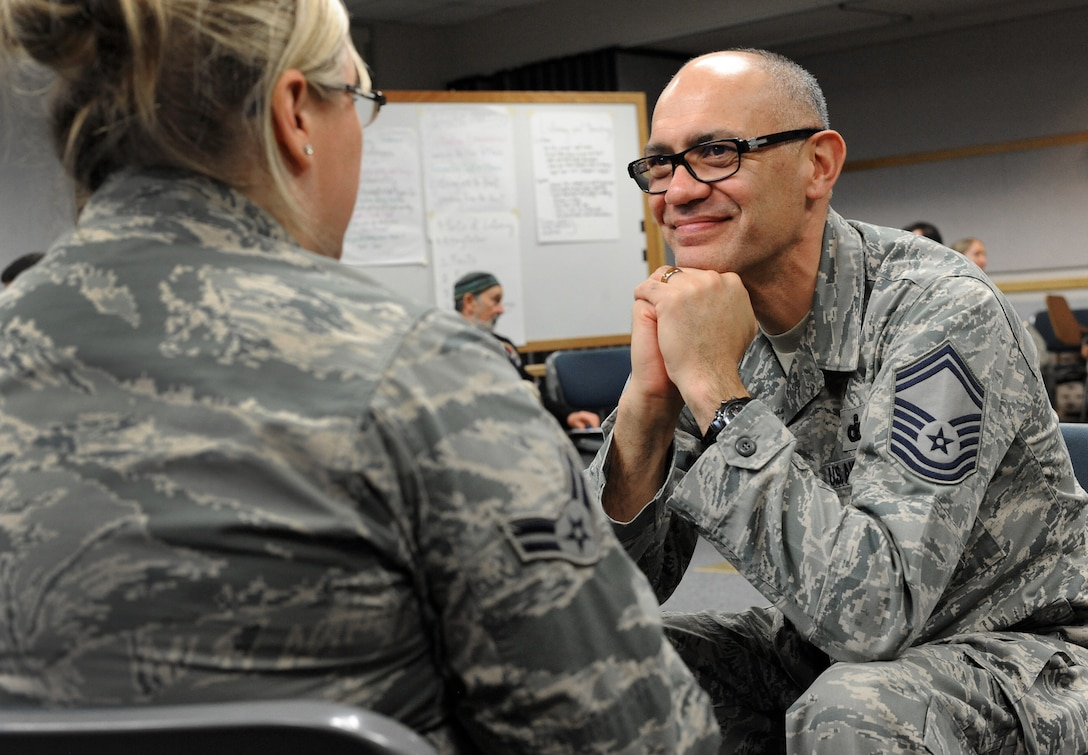 Oregon Air National Guard Senior Master Sgt. David Brunstad, right, quietly participates in a compassionate listing exercise with Airman 1st Class Michelle Johnson, left, during a meeting of the 142nd Fighter Wing's Diversity and Inclusion Counsel, Feb. 8, 2015, Portland Air National Guard Base, Ore. The Diversity and Inclusion Counsel meets during Unit Training Assembly weekends to help develop the total force crucial for mission success. (U.S. Air National Guard photo by Tech. Sgt. John Hughel, 142nd Fighter Wing Public Affairs/Released)