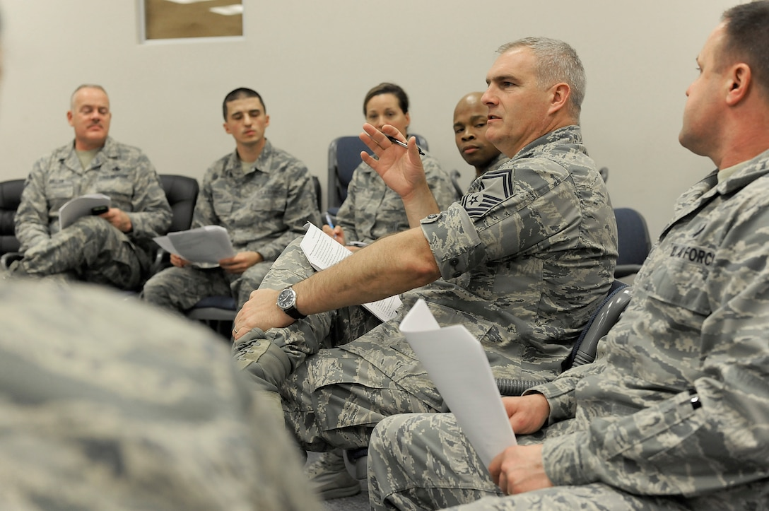 Oregon Air National Guard Senior Master Sgt. Robert Maca, center, participates in a group discussion as part of the unit's Diversity and Inclusion Counsel meeting, Jan. 11, 2015, Portland Air National Guard Base, Ore. The Diversity and Inclusion Counsel meets during Unit Training Assembly weekends to help develop the total force crucial for mission success. (U.S. Air National Guard photo by Tech. Sgt. John Hughel, 142nd Fighter Wing Public Affairs/Released)
