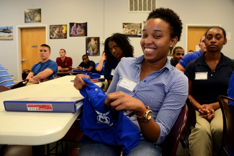 U.S. Air Force Airman Alexis Rush, assigned to the 169th Student Flight, holds up her Student Flight shirt at McEntire Joint National Guard Base, S.C., June 13, 2015. The trainees received shirts and binders that include useful information in a ceremony to help introduce them into the Swamp Fox family. (U.S. National Guard photo by Amn Megan Floyd/Released)