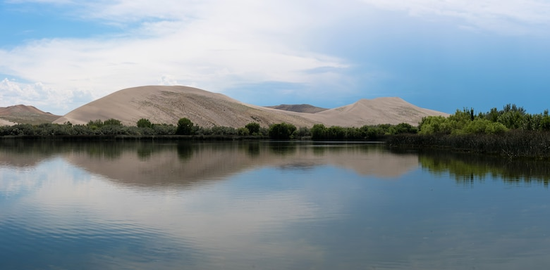 Dunes Lake at Bruneau Dunes state park, Idaho sits at the base of a 470-foot mountain of sand. At 4,800 acres, the park has plenty of space for hiking, camping and even horseback riding. (U.S. Air Force photo by Airman 1st Class Connor J. Marth)