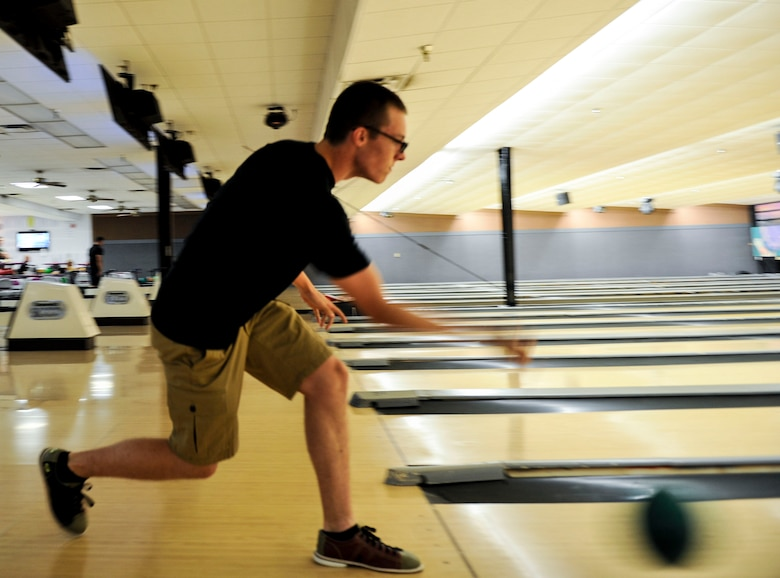Airman 1st Class Nicholas Chisler, a 19th Maintenance Squadron fuels systems operator, bowls for a spare July 8, 2015, at Little Rock Air Force Base, Ark. Strike Zone Bowling Center invites single active duty members to bowl for free on Monday nights from 6-9 p.m. (U.S. Air Force photo by Senior Airman Stephanie Serrano)