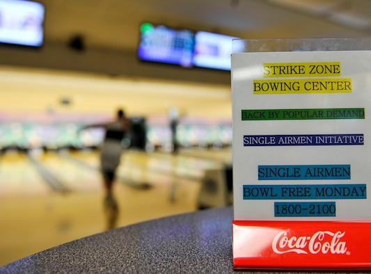 Strike Zone Bowling Center offers free Monday night bowling free to all single active duty members July 8, 2015, at Little Rock Air Force Base, Ark. Other specials include dollar days, cosmic bowling, league bowling, colorama, family fun day and more. (U.S. Air Force photo by Senior Airman Stephanie Serrano)