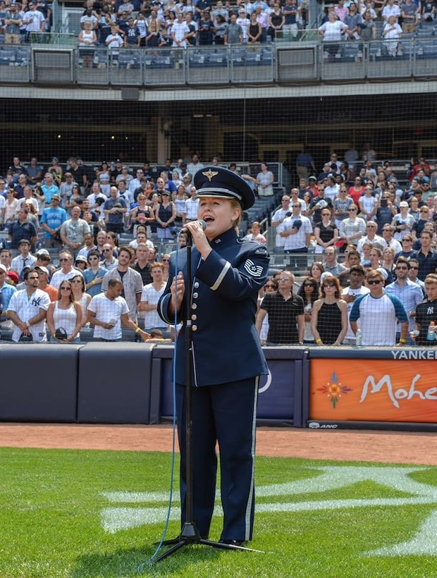 "Technical Sergeant Hannah Shirey sang ""God Bless America"" during the 7th inning stretch at the Yankees game on 5 July 2015. (U.S. Air Force Photo by 1st Lt. Esther Willett/released)"