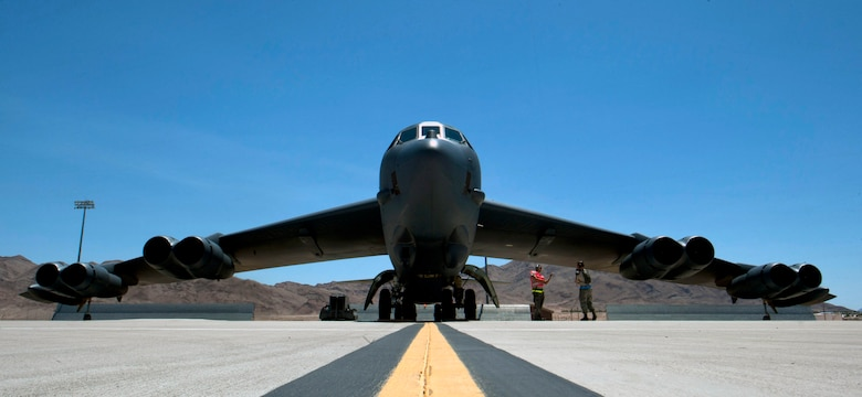 A B-52H Stratofortress assigned to the 69th Bomb Squadron, Minot Air Force Base, N.D., sits through pre-flight checks during Red Flag 15-3 at Nellis Air Force Base, Nev. July 15, 2015. The B-52 has a wide array of weapons at its disposal to dispose of an enemy and is capable of delivering approximately 70,000 pounds of munitions. (U.S. Air Force photo by Senior Airman Thomas Spangler)