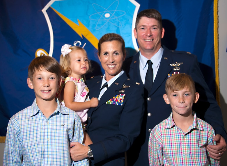 Lt. Col. Loralie Rasmussen, Officer Training School Detachment 12 commander, and her husband, Lt. Col. Reid Rasmussen, Air War College student, take a moment with their family after the change of command ceremony July 16, 2015, Maxwell Air Force Base, Alabama. The couple has three children, from left to right, Foster, Amelia Grace and Emmett. (U.S. Air Force photo by Airman 1st Class Alexa Culbert/Cleared)