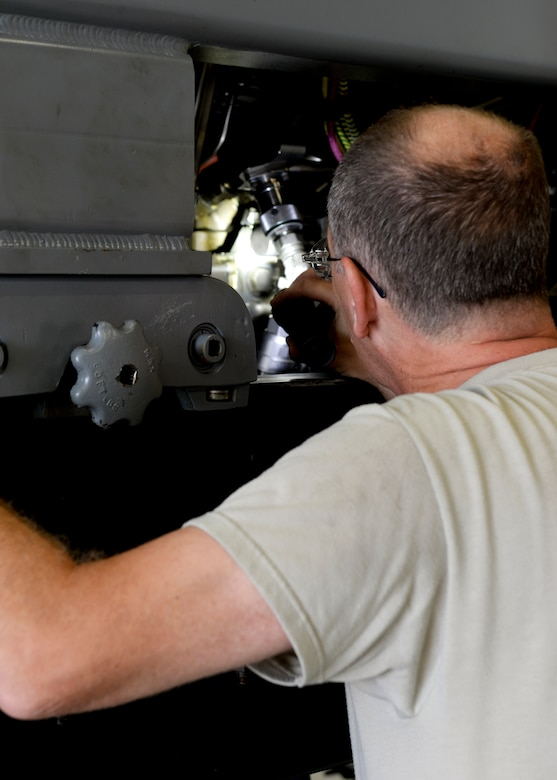 Virginia Air National Guard Master Sgt. Russell Tilley, 192nd Maintenance Squadron aerospace propulsion technician, checks wires for possible damage during a pre-test inspection on an F-22 Raptor engine at Langley Air Force Base, Va., July 22, 2015. Propulsion technicians conduct tests to ensure the engine is working properly. (U.S. Air Force photo by Airman 1st Class Derek Seifert/Released)