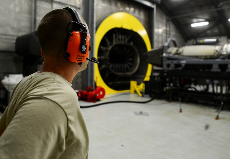 U.S. Air Force Senior Airman Michael Smith, 1st Maintenance Group aerospace propulsion technician, observes an engine run at Langley Air Force Base, Va., July 22, 2015. During the run, technicians check the engine for any leaks or discrepancies that require repair. (U.S. Air Force photo by Senior Airman Kayla Newman/Released)