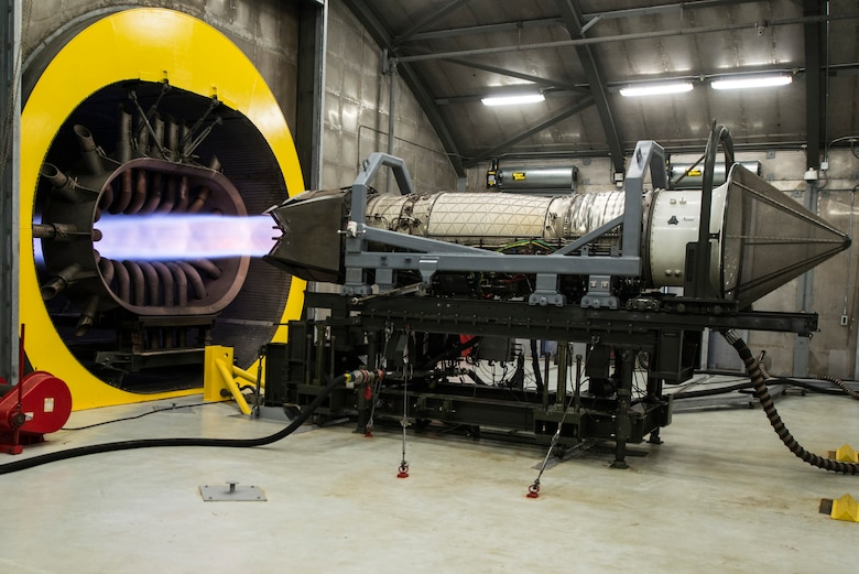 A Pratt and Whitney F119 engine performs an engine run at the 1st Maintenance Group propulsion flight Hush House at Langley Air Force Base, Va., July 22, 2015. The engine is connected to all electrical and mechanical propulsion systems as if it were installed in an aircraft, and is tested at maximum capability. (U.S. Air Force photo by Senior Airman Kayla Newman/Released)