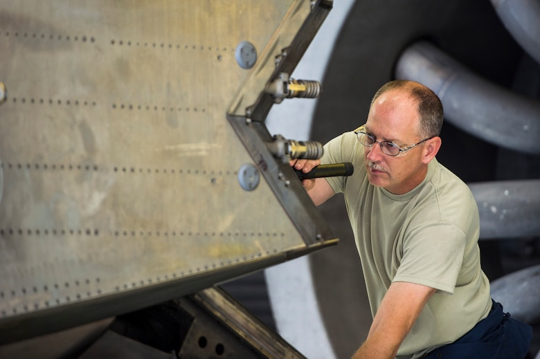 Virginia Air National Guard Master Sgt. Russell Tilley, 192nd Maintenance Squadron aerospace propulsion technician, conducts a pre-test inspection on a Pratt and Whitney F119 engine at Langley Air Force Base, Va., July 22, 2015. The engine powers the F-22 Raptor and produces more thrust than any other current fighter jet engine. (U.S. Air Force photo by Senior Airman Kayla Newman/Released)