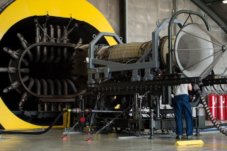 A U.S. Air Force Airman inspects an F-22 Raptor engine at Langley Air Force Base, Va., July 22, 2015. Propulsion technicians check engines for faults or leaks prior to performing tests. (U.S. Air Force photo by Senior Airman Kayla Newman/Released)